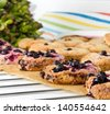 Homemade oatmeal cookies fresh out of the oven with blackberry - stock photo