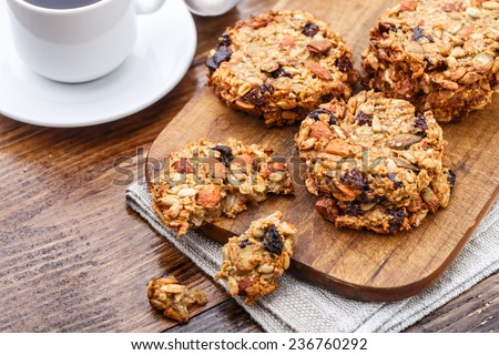 Homemade oatmeal cookies with seeds and raisin - stock photo