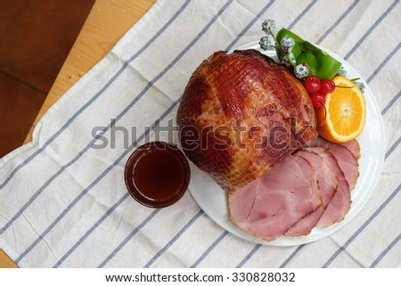 Homemade of Sliced Honey Gammon Ham with Orange, Cherry, Sweet Pepper and Honey Sauce for Festive dinner, Christmas dinner, Holiday table, Thanksgiving day celebration - Copy Space, From Above