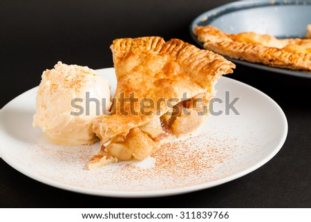 Homemade Organic Apple Pie on plate with cinnamon and ice cream. - stock photo