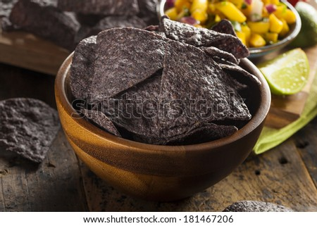 Homemade Organic Blue Corns Chips on a Background - stock photo