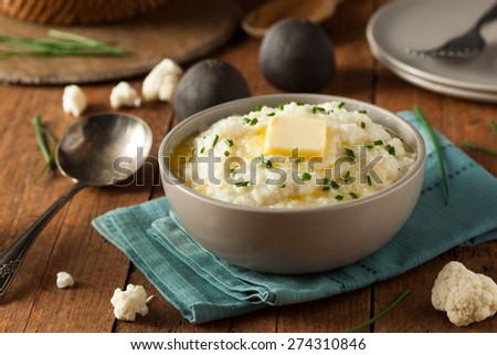 Homemade Organic Mashed Cauliflower with Butter and Chives - stock photo