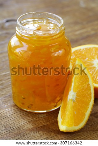 homemade organic orange marmalade jam with orange zest - stock photo