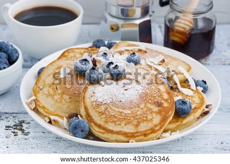 homemade pancakes with blueberries, honey and powdered sugar, closeup - stock photo