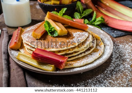 Homemade pancakes with roasted rhubarb, sweet pancakes with sour rhubarb is delicious combination