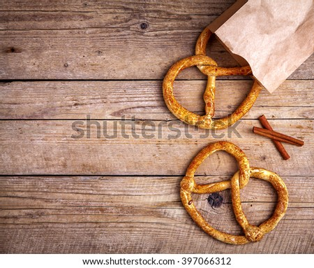 Homemade pastries. Pretzel on wooden background. Food - stock photo
