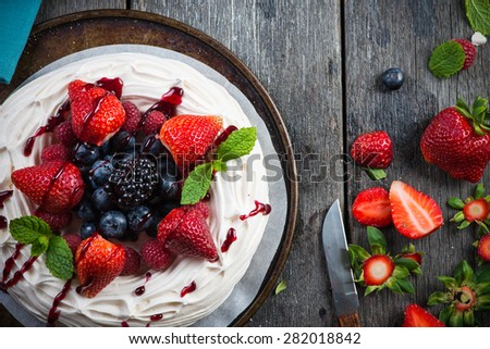 Homemade pavlova meringue with summer fresh berries fruits