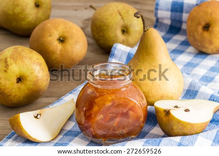 homemade pear jam on wooden board on background fresh ripe pears - stock photo