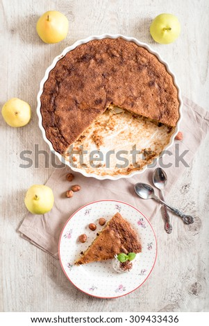 Homemade pear pie with nougat served in the plate,from above - stock photo