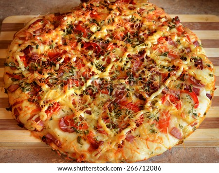 Homemade pizza, made on homemade recipes, round pizza with delicious fillings - stock photo