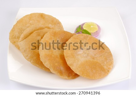 Homemade Poori or puri, also known as Indian fried bread - stock photo