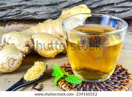 Homemade portion of fresh Ginger Tea - stock photo