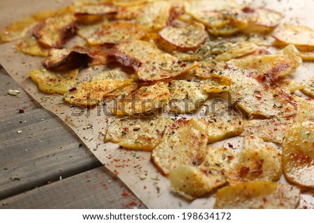 Homemade potato chips close up - stock photo
