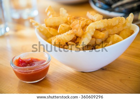 Homemade potato fries with tomato sauce