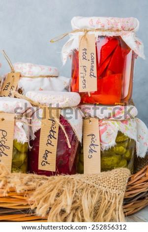Homemade preserved vegetables in jars - stock photo