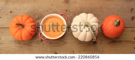 Homemade pumpkin soup on wood background - stock photo