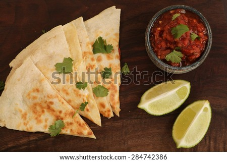 Homemade Quesadilla on a unique serving tray - stock photo