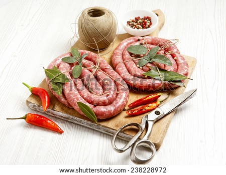 homemade raw sausage with herbs aromatic & fresh red pepper. ready for cooking.  - stock photo