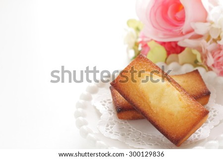 Homemade rectangle cake with flower on background - stock photo