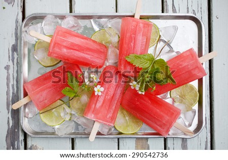 Homemade rhubarb strawberry popsicles - stock photo