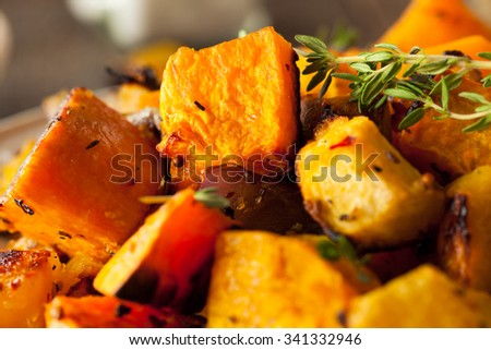 Homemade Roasted Root Vegetables with Squash and Pumpkin - stock photo