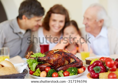 Homemade roasted turkey on served Thanksgiving table - stock photo