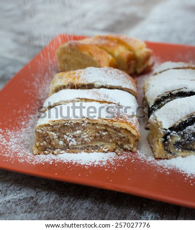 Homemade roll cake with poppy seeds, walnut and cheese - stock photo
