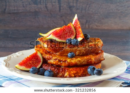 Homemade rustic french toast with fig and blueberries  - stock photo