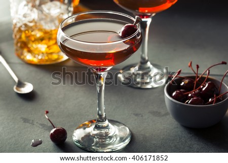 Homemade Rye Bourbon Manhattan with a Cherry Garnish