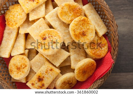 Homemade salty crackers with red paprika - stock photo