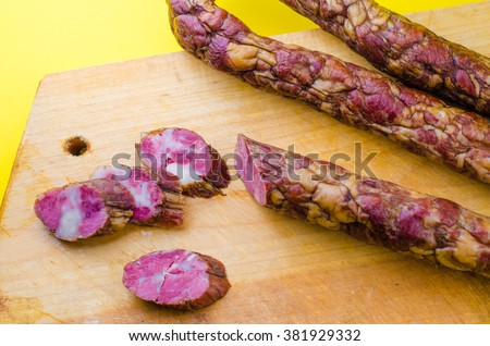 homemade sausage on yellow background - stock photo