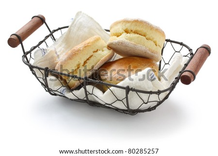 homemade scones in a basket , buttermilk biscuits - stock photo