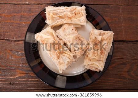 Homemade semolina and cinnamon sweet cake - stock photo