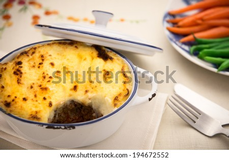 Homemade shepard pie with beef topped with golden mashed potato - stock photo