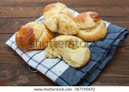 Homemade small bread with butter - stock photo