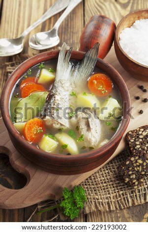 Homemade soup of river fish in the bowl on the table