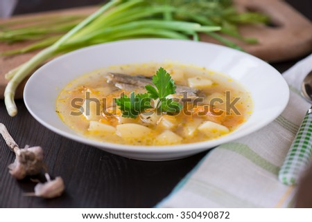 Homemade soup of river fish in the plate