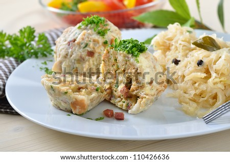 Homemade South Tyrolean bacon dumplings with sauerkraut - stock photo