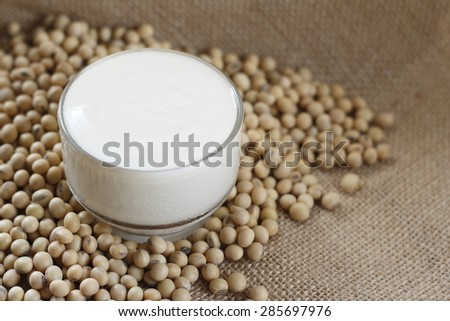 homemade soy milk yogurt with soy bean place on jute clothe. homemade soy milk yoghurt. soy milk yogurt. homemade yogurt. - stock photo