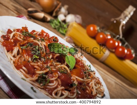 Homemade Spaghetti Bolognese on a wooden background - stock photo
