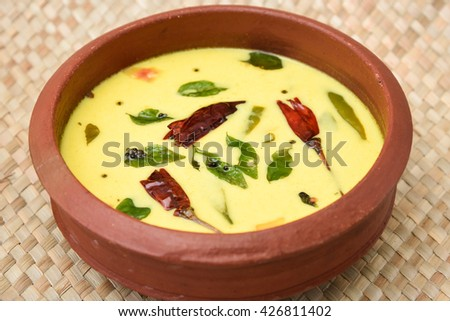 Homemade  spiced butter milk or butter milk or moru or curd curry in clay pot made from cow milk in Kerala, India. Indian flavoured buttermilk. - stock photo