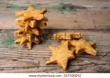Homemade star shaped carrot cookies on a shabby wooden background