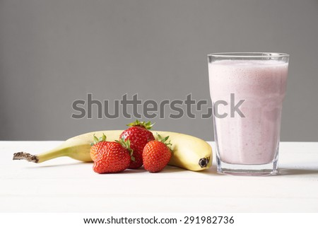 homemade strawberry and banana smoothie or milk shake                               - stock photo