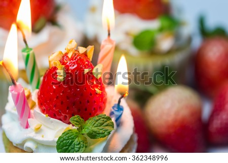 Homemade strawberry cupcakes. Decorate with cream, fresh strawberry and mint. It looks yummy. You can apply for website decor, birthday card,background,wallpaper and artwork design.