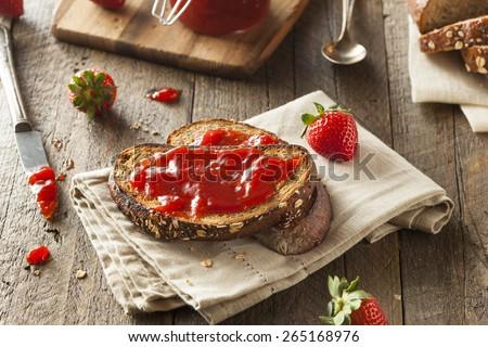 Homemade Strawberry Jelly on Whole Wheat Toast - stock photo