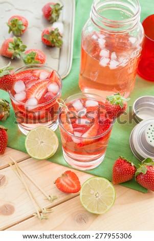 Homemade strawberry lemonade or sangria with fresh lime - stock photo