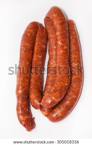 Homemade stuffed sausage on the white background. - stock photo