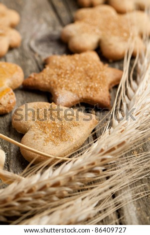 Homemade sugar cookies with rye on old wooden table