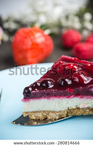 Homemade summer berries fruit cheesecake on wooden table