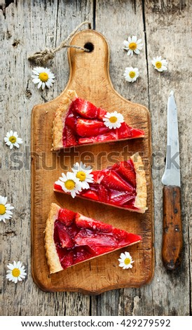 Homemade summer strawberry jelly cake on rustic wooden background - stock photo